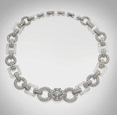 Cartier  Composed of graduated links of diamonds and rock crystal, tapering to a front motif set with a highly important octagonal cut diamond, circa.1930