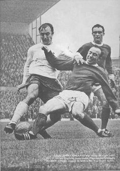9th October 1969. Tottenham Hotspur hot shot Jimmy Greaves finds his way blocked by a tenacious Nobby Stiles in the colours of Manchester United.