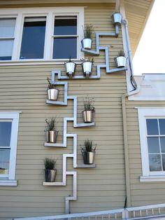 Downspout planter. http://impressivemagazine.com/2014/12/31/30-downspouts-and-rain-chains-creative-designs/