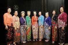 A group of women posing in traditional Peranakan nonya kebaya