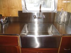 Stainless-steel countertops make for easy cleanup and give vintage campers a high-end feel.