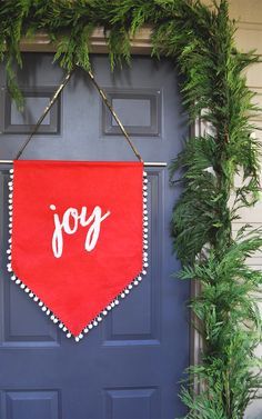 Front Door Decor on a Budget   An easy holiday DIY!  This Joy Banner took about a half hour to make and really creates a statement.  Check out the blog for a link to the DIY and see how I decorated with thrifted items from the Salvation Army Thrift Store.  http://aplentifullife.ca/front-door-decor-on-a-budget/