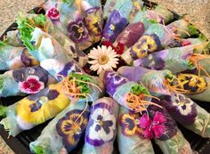 Fresh summer rolls with organic edible flowers for catering. sdthai.com