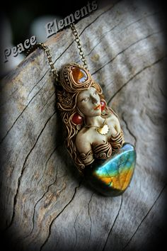 Goddess of rainbow Iris Fully hand Sculpted clay pendant