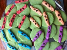 TMNT cookies- looks easy enough... Green sugar cookie w/ stripe of colored frosting & mini choc chip eyes