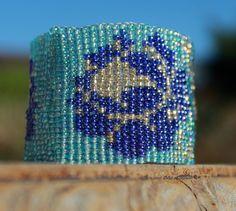 Items similar to Blue roses, loom beaded bracelet on Etsy Blue Roses, Loom, Cuff Bracelets, Handmade Jewelry, Etsy, Loom Knitting, Bangles, Handmade Jewellery, Craft Jewelry