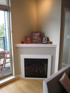 Corner fireplace.  Continue straight up, tv over, raise fireplace off the floor a little more, with a niche over/under the tv.