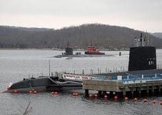 The Virginia-class attack submarine USS New Hampshire (SSN 778) passes the historic ship Nautilus (SSN 571) as it departs Naval Submarine Base New London for deployment.