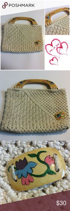 """Boho Crochet Wooden Handle Purse Gently used boho crocheted wooden handle purse.  Has painted design on handles and one added to the purse. Purse measures 12 3/4"""" length by 9"""" tall and 3-4"""" depth depends on how much you put in it.  Handle drop 3"""".  Any questions please ask.  I do consider reasonable offers.  Thank you and have a wonderful day💕💕💕 Bags Totes"""