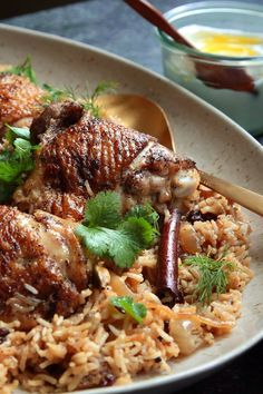 """NYT Cooking: A stunningly fragrant one-pot meal, this chicken and rice dish came to The Times from Yotam Ottolenghi and Sami Tamimi's smash hit """"Jerusalem: A Cookbook."""" Spiced with cinnamon, cardamom and whole cloves, its aromatic earthiness is balanced by plenty of herbs — dill, parsley and cilantro — for freshness and tang. And caramelized onions and dried barberries (or currants) contri..."""