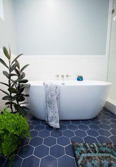 Hexagon blue floor tile with white subway tile; modern fresh bathroom tile by Fireclay Tile