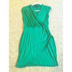 VENUS Sleeveless Green Dress (Small) VENUS Sleeveless Green Dress (Small) super comfy yet stylish. Never worn!! Didn't fit me the way I wanted it to so I have never work it out. Looks best with seamless underwear (no lines!) perfect for summertime & can be both casual & dressy!  Venus Dresses Mini