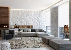 panneau mural blanc 3D dans le salon avec canapé gris, coussins et tapis à motifs géométriques