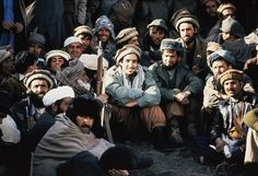 Afghan guerrilla leader Ahmad Shah Massoud, surrounded by the Mujahideen, 1984.