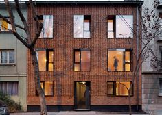 Chilean studio MAPA has converted a vacant building in Santiago into an apartment block covered in zigzigging brickwork
