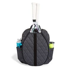 Cinda B Python Tennis Backpack NEW from Cinda B! This backpack bag can hold 2 standard size tennis racquets in the exterior pocket that features a bias trim. There is a slip pocket on both sides of th