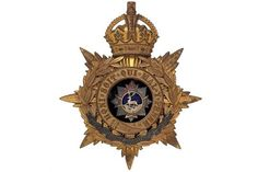 Badge. Bedfordshire Regiment Officer's helmet plate circa 1901-14. A good gilt example. Crowned s