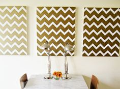 Glam up your dining room with this simple chevron artwork. All you need is painter's tape and gold paint.