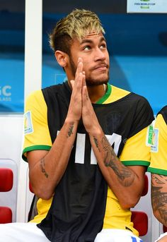 JULY 12: An injured Neymar of Brazil looks on from the bench during the 2014 FIFA World Cup Brazil Third Place Playoff match between Brazil and the Netherlands at Estadio Nacional on July 12, 2014 in Brasilia, Brazil