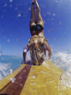 Female Surfer Doing a Headstand on a Surfboard Photographic Print at Art.com