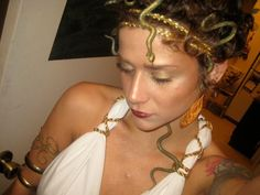 Medusa costume with only a bed sheet, gold rope, rubber snakes, and large bobby pins. Add some gold glitter and get creative!
