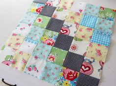 Scrappy Trips around the World by Bonnie Hunter. By making the middle diagonal row the same color in every block, you'll have a more uniform look to the finished quilt.