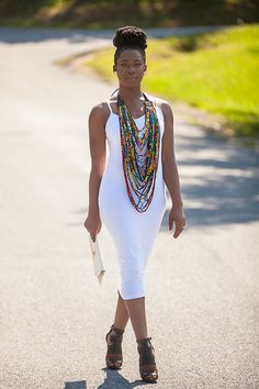 Picture the white dress with that colorful statement necklace just beautiful.
