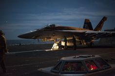 F/A-18E Super Hornet from the Sunliners of Strike Fighter Squadron (VFA) 81 about to be launched from flight deck of USS Carl Vinson (CVN 70). U.S. Navy CAG birds (aircraft in special liveries, off...