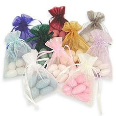 Organza bags filled with your favourite candy for guests to enjoy and love!    www.beautybride.ca