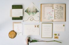 Evr Paper Co., an online custom paper shop based in Chicago, creates charming nuptial invitations depicting hand-painted illustrations of florals, landscapes, and cityscapes. Featuring a watercolor woodland scene, this earthily elegant invitation suite was designed for a wedding at the Morton Arboretum.