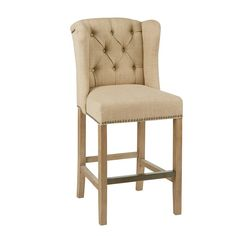 Tapered legs, button-tufted upholstery and a subtle wrap-around back bring this cozy counter stool a classic inviting look great for filling out your dining room ensemble.