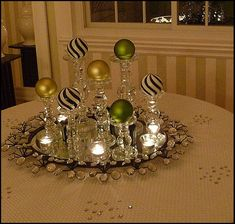 elegant sparkle at night for Christmas using black and white striped ornaments with chartreuse and lime green, clear glass candlesticks