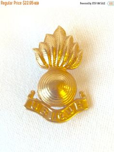 UBIQUE Badge - 22 carat gold plated white metal with brass pins and butterfly clips by StudioVintage on Etsy
