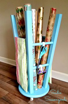 Repurposed wooden bar stool to organize, store, and hold rolls of wrapping paper and gift wrap supplies by Sadie Seasongoods / www.sadieseasongoods.com