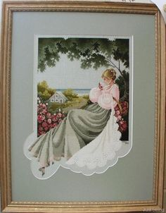 Nantucket Rose - by cross stitch designer Marilyn Leavitt-Imblum / Told in a Garden.  Her free Christmas Angels (click) can be found on this site Just Strings.