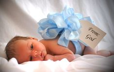 Cute Newborn Baby Boy One Month Old From GOD Picture- to do this with Stormy would be awesome because we have a black and white one with a pink bow of Hannah from when she was born. I like that it would be symmetry.