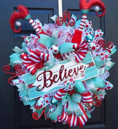 Christmas Deco Mesh Wreath - Christmas Front Door Wreath - Christmas Elf Wreath - Deco Mesh Wreath - Door Wreath - Mesh Wreath - Christmas This whimsical Christmas elf wreath is sure to be a showstopper! All in the new hot colors of turquoise and red! Made with layered ruffles of