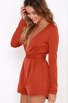 Take the plunge and reap the benefits of looking glam in the Steep Slope Rust Red Long Sleeve Romper