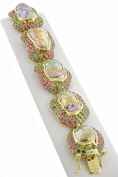 "2015 Spectrum Awards- Best Use of Color  Paula Crevoshay, Crevoshay - 18K yellow gold ""The Venus Bracelet"" featuring freshwater baroque cultured Pearls (91.43 ctw.) accented with pink and green Tourmalines (29.32 ctw.)."