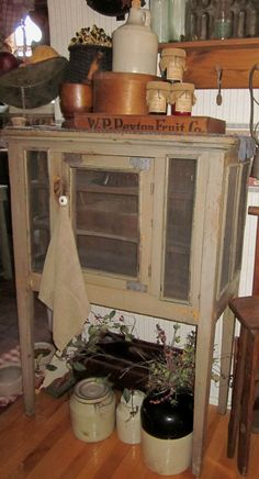 Antique Pie Safe & Old Crocks.I love the pie safe. Primitive Cabinets, Primitive Kitchen, Primitive Furniture, Primitive Antiques, Primitive Crafts, Country Primitive, Country Sampler, Country Furniture, Primitive Homes