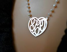 Check out this item in my Etsy shop https://www.etsy.com/listing/255509944/monogram-name-heart-necklacepearl-chain