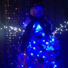 White snow man tree with blue lights. I bought snow man head at Cracker Barrel