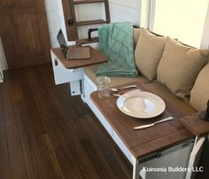 Great space saving ideas in this tiny house for the couch to have!! Hide-a-way tables!