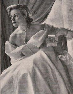 April 1949. Simone Imbert (Jacques Fath's sister-in-law) in Jacques Fath dress.  I love wearing pearls casually tied.  The only problem is, I constantly want to play with them!