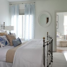 Just a hint of light blue in the wall color.  Blue curtains and blue pillows continue the theme.  Room does not seem too blue - blue is punctuated by tan and white.