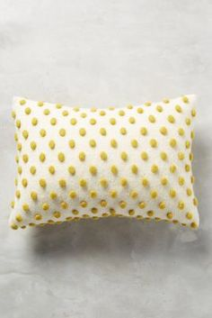 Anthropologie Woolen Pom Pillow https://www.anthropologie.com/shop/woolen-pom-pillow?cm_mmc=userselection-_-product-_-share-_-36805026