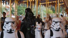 Darth Vadar and storm troupers on the merry go ground