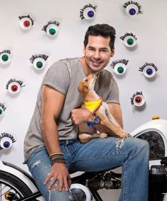 Dino Morea poses with a pup for the calendar of World For All