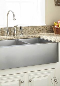 The design of this double-bowl stainless steel sink is practically made for the cook of the family since it makes food prep and dishwashing a breeze. It's the perfect addition to a modern kitchen.