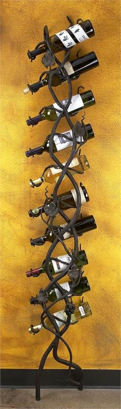 """Wrought Iron Wall Wine Holder- 10 Bottle by Bella Toscana Hand forged wrought iron with hand painted details makes the """"Wrought Iron Wall Wine Holder- 10 Bottle"""" unique and one of a kind. Wrought Iron Decor, Iron Wall Decor, Wall Wine Holder, Whisky, Wine Rack Bar, Wine Stand, Towel Holder, Towel Racks, Bar Accessories"""